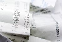a paper receipt with the list of economic issues. Business and economics.