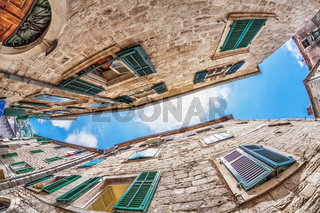 Fish-eye view of the old city on sky background