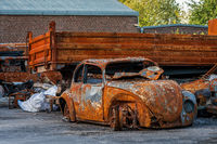 Rusted burnt out car wrecks