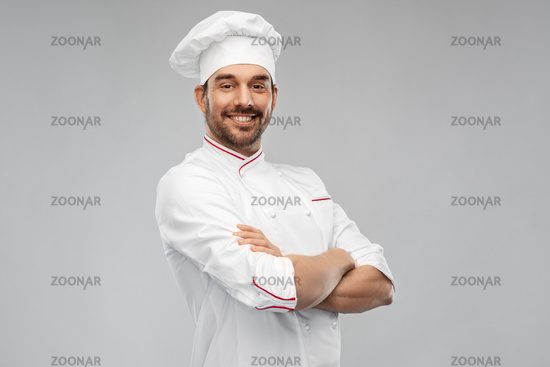 happy smiling male chef in toque