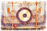 Traditional oriental gong on a beautiful ornamental background. Painting effect.