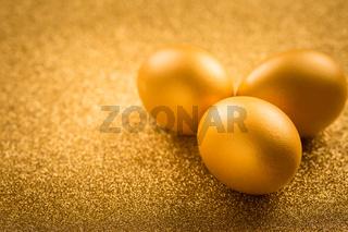 Golden eggs on golden background for Easter