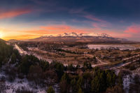 sunset over the sub-Tatra town of Svit with the river Poprad