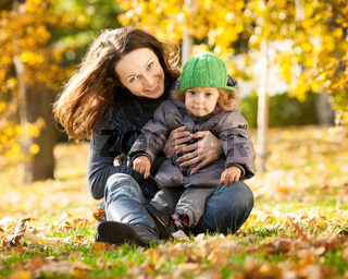 Woman with child having fun in autumn