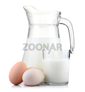 Jug of milk and glass with eggs isolated on white
