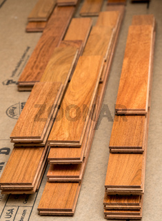 Stack of planks of brazilian Cherry hardwood flooring pieces ready for installation