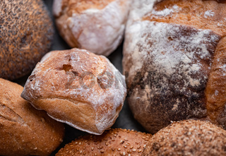 Freshly baked natural bread is on the kitchen table.