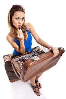 Traveller woman applying makeup