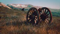 historic war gun on the hill at sunset