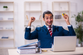 Young businessman employee in e-commerce concept