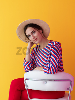 Portrait of young woman sitting on the chair