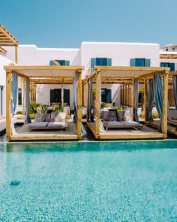 Paralia Platis Gialos beach Mykonos, Petinos beach Mikonos island Greece, luxury beach bed chairs and blue ocean