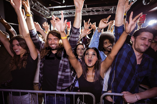 Happy crowd enjoying at music festival