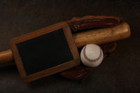 Baseball ball, wooden bat and vintage glove