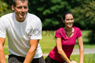 Close up portrait of couple stretching outdoors