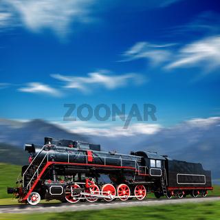 Speeding old locomotive in mountains