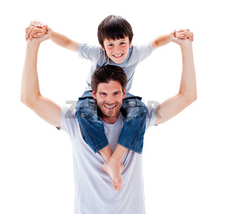 Charismatic father giving his son piggyback ride