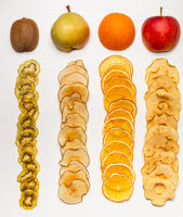 The dry pieces of different fruits elongated in a row to fresh fruits