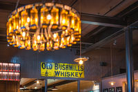 Old Bushmills Whiskey sign in distillery visitor centre, bar and shop