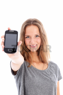 Teenager holding up a mobile phone