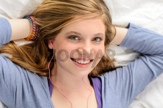 Portrait of relaxing young girl listening music