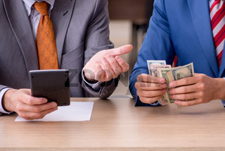 Two male employees in remuneration concept