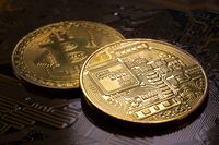 Two Bitcoin coins and printed circuit board PCB