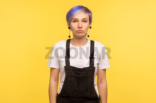 Portrait of emotional hipster woman on yellow background.
