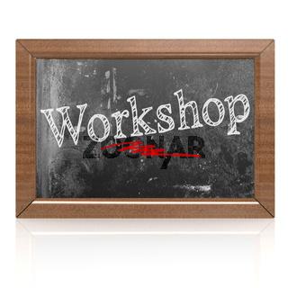Workshop text written on blackboard