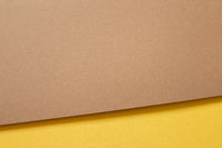 Brown and yellow layered color paper background. top view