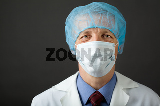 Male physician in mask and cap