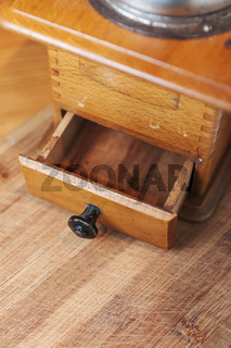Coffee grinder with open drawer