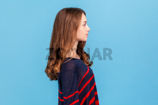 Portrait of young emotional woman on blue background.