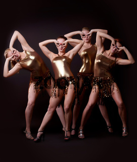 Group of women posing in gold costume