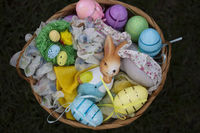 Easter basket with decorative eggs and bunny figurine.