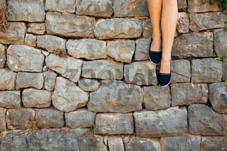 Female feet on a stone floor