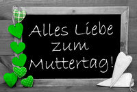 Balckboard With Green Heart Decoration, Text Muttertag Means Mothers Day