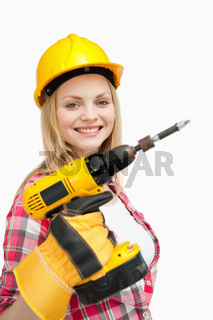 Woman smiling while holding an electric screwdriver