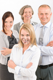 Business team young woman with mature colleagues