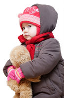 Baby in winter clothes on a white background