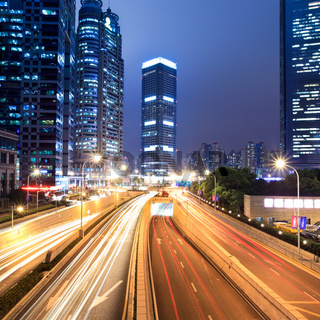 light trails on shanghai financial center at night