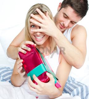 Boyfriend giving a surprise to her girlfriend
