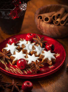 Homemade gingerbread star cookies for Christmas on the plate