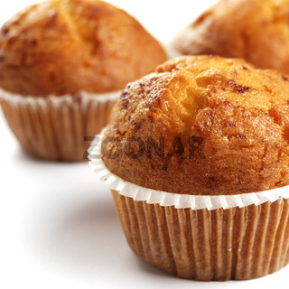 Three muffins on the white background