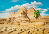 Sphinx and pyramid ruins