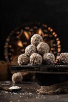 still life photo of healthy, homemade, delicious sweets. Tasty lactose and sugar free coconut balls with healthy ingredients