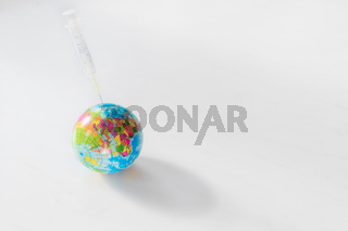 Positive bright symbol for global vaccination against covid-19 on the earth with syringe in planet