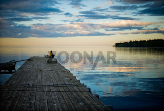 fisherman sitting in the pier