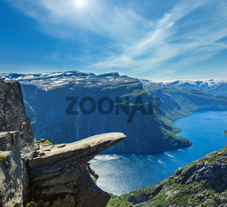 The summer sunshiny view of Trolltunga (famous The Troll's tongue Norvegian destination) and Ringedalsvatnet lake in Odda, Roldal, Norway.