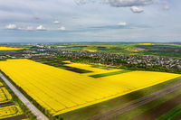 Clouds above agricultural rape field, aerial shot